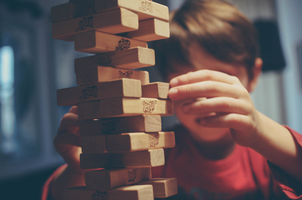 A child playing with Jenga, used as an introduction to gamification.
