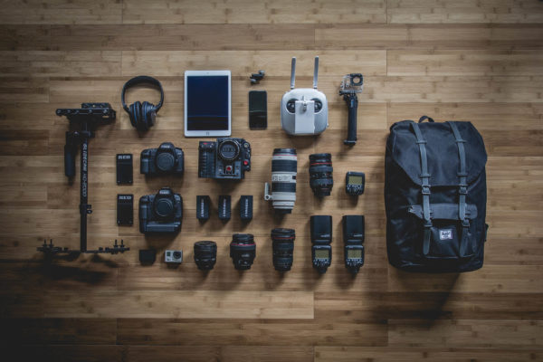 An image showing various camera equipment laid out in a structured manner. The point is to illustrate deconstruction
