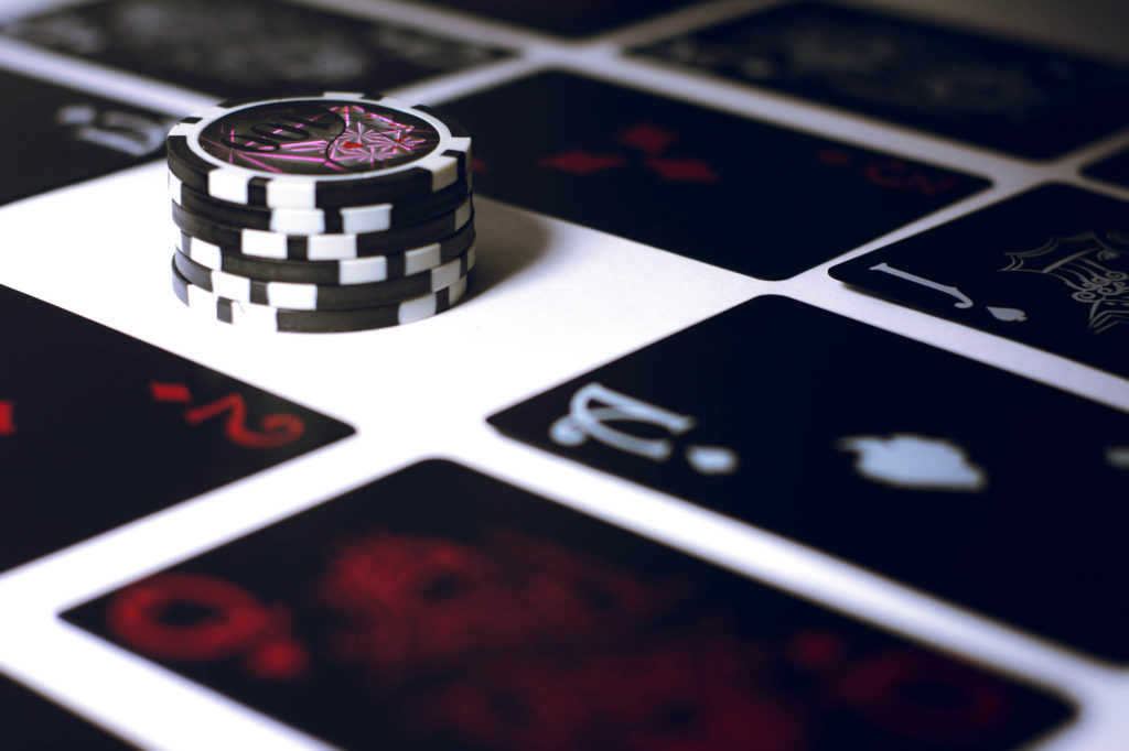 Stakes: How To Actually Hold Yourself Accountable - An image with a black deck of cards and casino chips