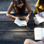 A group of students studying outdoors together, used as the featured image for the article on how to motivate yourself to study.