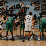 A photo from a basketball match, where the player is ready to shoot a free-throw. As basketball is a great application for overlearning, the image is used as an illustration of the concept.